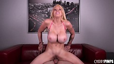 Her big tits sensuously bounce as she rides that cock with fervor and passion