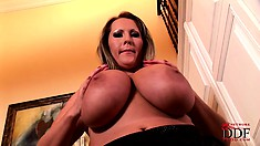 Dropping her black dress, the sexy cougar shows off her huge boobs and sexy ass