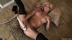 Blonde bimbo in stockings twitches like crazy with a magic wand
