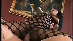 Beautiful dark skinned babe in a hot fishnet bodysuit Lady Armani loves hardcore sex