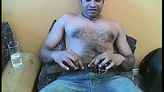 Hairy chested man sits down to have some fun with a hung white guy