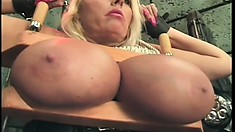 Her huge breasts are mercilessly tortured by her jealous mistress