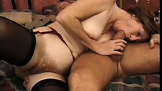 Naughty mature lady enjoys a hard pounding on the bed and then swallows a huge load