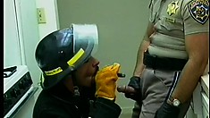 Dick-greedy fireman goes down on a hung policeman and gets a favor in return