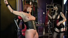 Kinky lesbian Mistress gets rough with her sexy redheaded slave