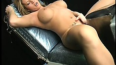 She masturbates until she is wet enough for the machine to fuck her