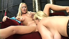 Petite blondie in a jean skirt gets eaten out by her sexy girlfriend