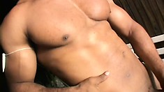 Hot black dude shows off his amazingly ripped body and thick prick