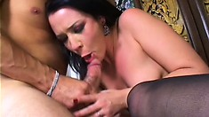 Sexy milf in stockings plays with a dildo and gets fucked by a big cock