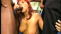 Gorgeous redhead gets her face and ass stuffed in a threesome