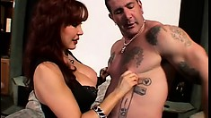 Luscious redhead cougar with big boobs gets pounded by a tattooed stud