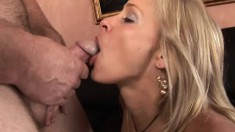 MILF takes off her little black dress and helps him get hard