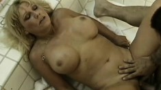 Big breasted mature lady gets pounded by a hung stud in the bathroom